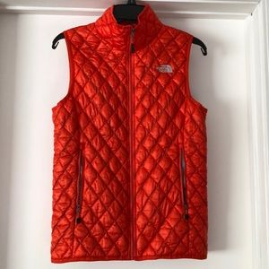 Orange North Face Vest